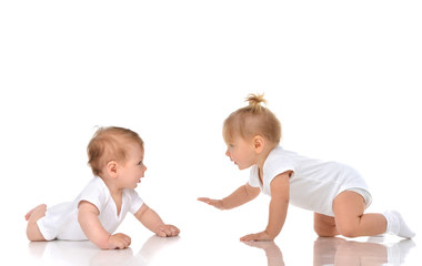 Two Infant child baby girl toddler crawling happy each other