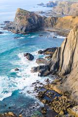 Atlantic ocean rocky coastline near Arrifana. Vicentina Coast Natural Park. Algarve region. Portugal