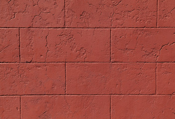 Red cinder block wall forms a pattern that can be used for backgrounds.