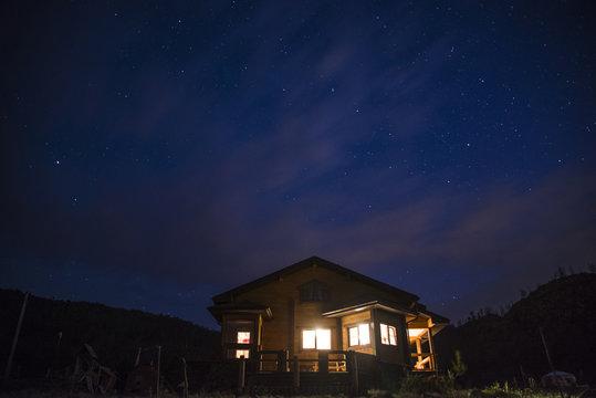 Wonderful starry sky above the farm house.