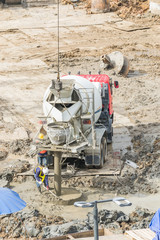 Construction workers are preparing pump for concrete for pouring