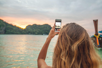 Woman taking photos in Thailand
