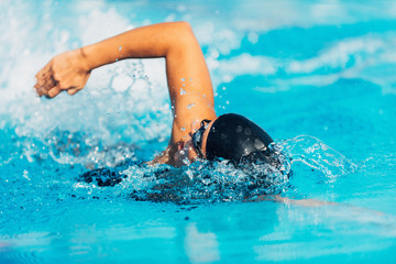 Swimmer. Female swimmer swimming front crawl