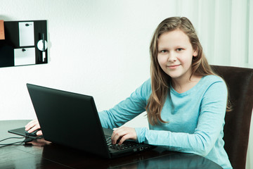 monochrome portrait young pretty girl using the laptop