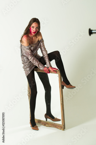 zombie bloody girl with mirror stock photo and royalty