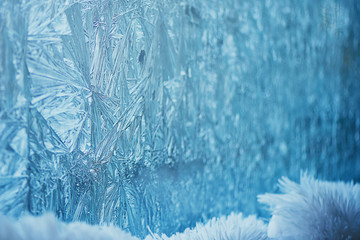 The frost on the window in cold tones. The background