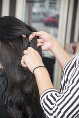 Hairdresser working with beautiful woman hair in hairdressing sa