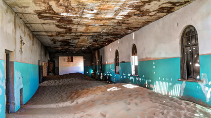 Interior of ruined house in ghost-town Kolmanskop, Namibia