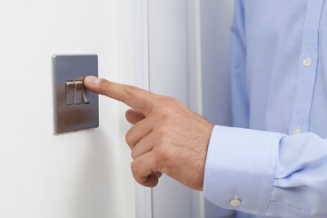 Close Up Of Man Turning Off Light Switch