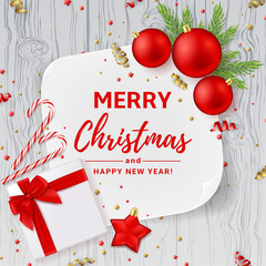 Christmas or New Year decoration background. Vector illustration. Top view on Xmas composition with gift box, golden confetti and red balls. Festive backdrop with greeting card and on wooden texture.