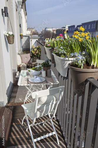 Potted Spring Flowers On A Sunny Balcony Stock Photo And