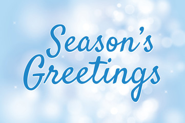 Season's greetings with blue bokeh background for christmas them
