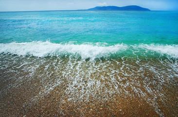 blue wave on the sand sea beach