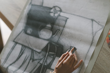 Young woman drawing a picture. Selective focus and small depth of fields.