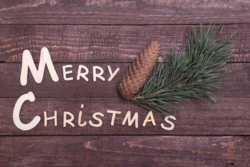 Christmas collection, gifts box, tree and decorative ball, on wood background.