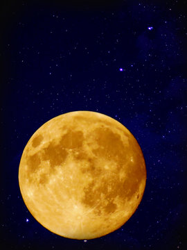 Full yellow moon with star at dark night sky background