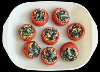 Tomatoes Stuffed With Spinach In White Ceramic Baking Pan Isolated On Black Background