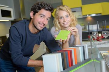 Couple choosing color scheme for kitchen