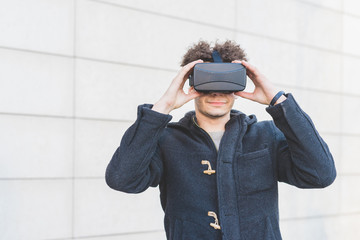 Young man using 3D viewer