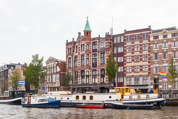 Amsterdam city view with canals in Holland