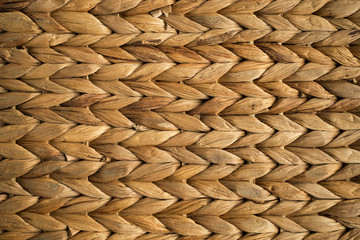 Wicker texture of beige basket. Pattern for abstract background or texture. Overhead view