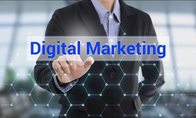 Businessman hand pressing button digital marketing. sign on virtual screen. business concept.