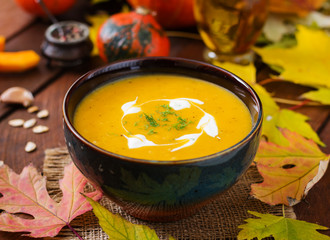Cream of pumpkin soup with sour cream sauce. Halloween.