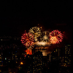 Fireworks over beautiful night city view in Vancouver, Canada.