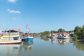Typical Traditional Fishing Boats in a Harbour at Phetchaburi, Thailand and Blue Sky