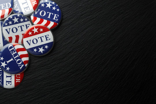 Red, white, and blue vote buttons background