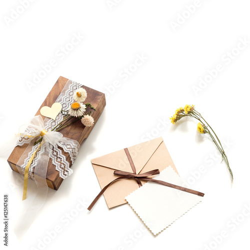 Beautiful handmade gift box (package) with flowers, envelope with