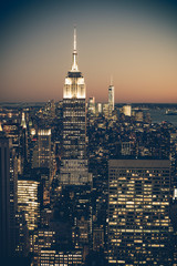 Wall Mural - Vintage tone image of New York City at dusk with buildings and lights