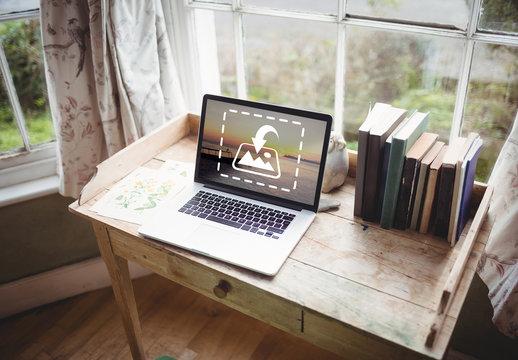 Laptop on Rustic Desk Mockup