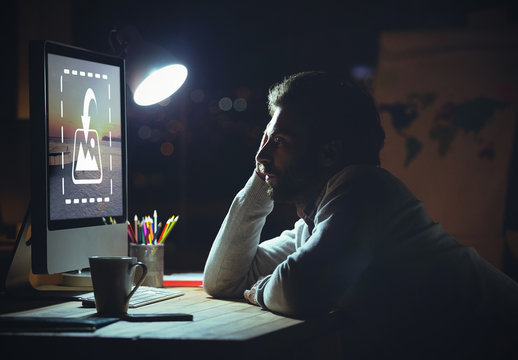 Man Using Desktop Computer at Night Mockup