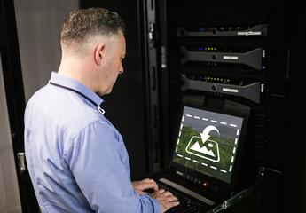Technician Using Laptop Mockup 2