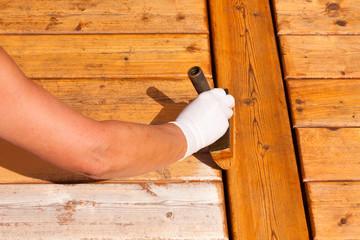 Wooden deck maintenance apply stain on decking