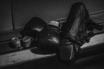 Equipment for Thai boxing, pads, knee pads, bandages, gloves lying on the bench in the sports hall