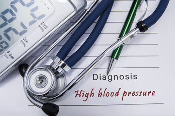 Diagnosis High blood pressure. Stethoscope and electronic sphygmomanometer lie on medical paper form with cardiac diagnosis High blood pressure related to group hypertensive diseases