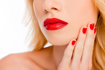 Close up of big woman's red lips and hand with red manicure