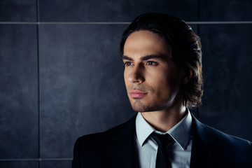 Closeup portrait of handsome hispanic young man in formalwear lo