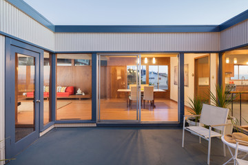 Sliding doors within open Courtyard at twilight.