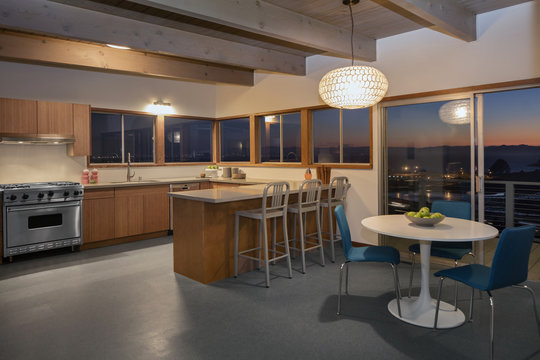 Amazing kitchen at night with mountain view.
