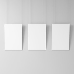Three posters on the ropes, White blank poster mockup hanging on the wall, 3d rendering