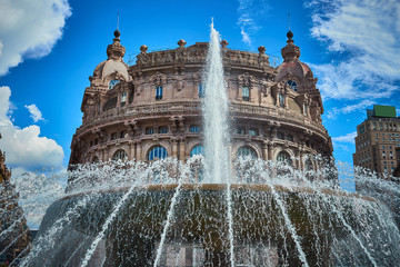"""Palazzo della Borsa"" and great fountain at central Place in Genoa / Historical center of Genoa at ""Piazza de Ferrari"""