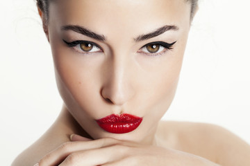 closeup woman portrait with red lips and black eyeliner