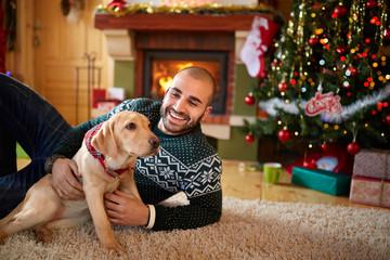 Man with his dog on Christmas eve