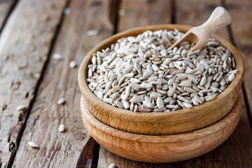 sunflower seeds in a wooden bowl