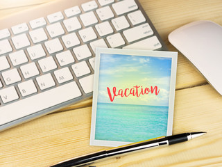 Vacation on beach picture on work table