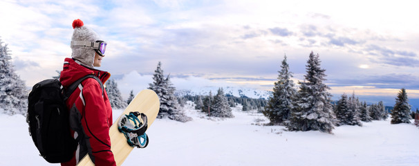 Woman with snowboard on mountain