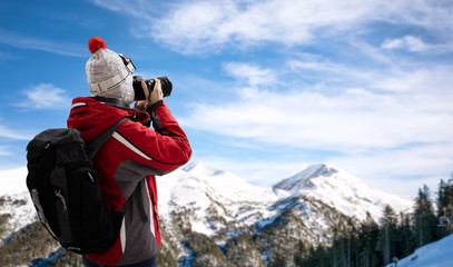Woman in ski suit takes picture